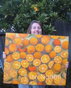 Jen Norton with her painting of oranges and persimmons